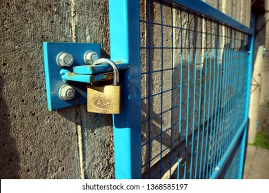 Birmingham, UK - April 12 2019: An Asec branded padlock holding a gate at Birmingham Wholesale Markets Precinct that is currently under demolition