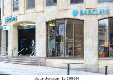 BIRMINGHAM, UK - APRIL 19, 2013: People visit Barclays Bank in Birmingham, UK. Barclays is a multinational finance and banking group based in London, United Kingdom.