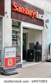 BIRMINGHAM, UK - APRIL 19: People shop at Sainsbury's Local on April 19, 2013 in Birmingham, UK. J Sainsbury is the 3rd largest supermarket chain in the UK with 16.5% market share.