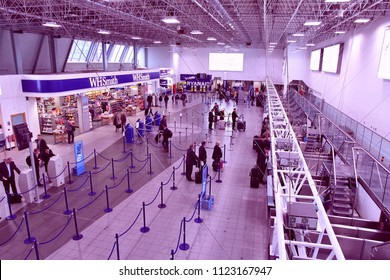BIRMINGHAM, UK - APRIL 24, 2013: Travelers queue on April 24, 2013 at Birmingham International Airport, UK. With 8.9 million travelers served it was the 7th busiest UK airport in 2012.