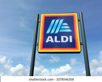 Birmingham, UK: April 26, 2018: Commercial sign of ALDI Store against a blue sky. ALDI is a large discount supermarket chain with app. 4200 stores in Germany. It specializes in lower priced products.