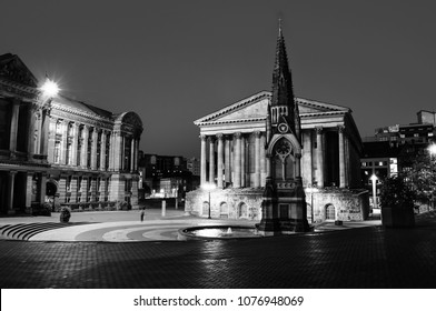 Birmingham, UK. Chamberlain square at night with illuminated Town Hall and Chamberlain Memorial before the major demolition and reconstruction. Clear blue sky in Birmingham, UK. Black and white