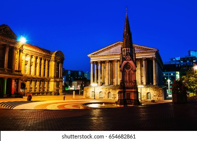 Birmingham, UK. Chamberlain square at night with illuminated Town Hall and Chamberlain Memorial before the major demolition and reconstruction. Clear blue sky