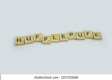 Birmingham, UK - December 2018: Scrabble letters spelling 'HUFFLEPUFF' on a white background