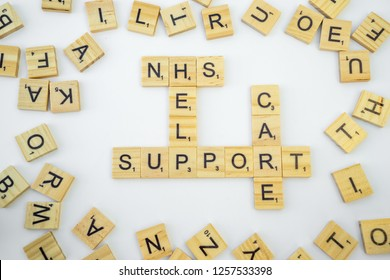 Birmingham, UK - December 2018: Scrabble letters spelling NHS, Help, Support, Care