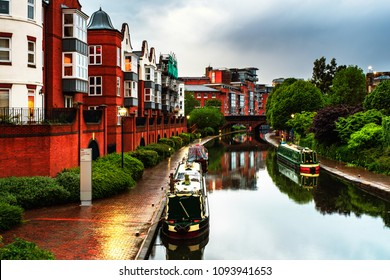 Birmingham, UK. Embankments during the rain in the evening at famous Birmingham canal in UK. Cloudy blue sky at night