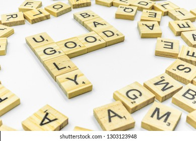 Birmingham, UK - February 2019: Scrabble letters spelling 'Good Bad Ugly' on a white background