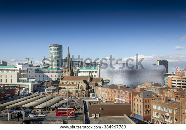 BIRMINGHAM, UK - February 24 2016: View of the skyline of Birmingham, UK including The church of St Martin, the Bullring shopping centre and the outdoor market.