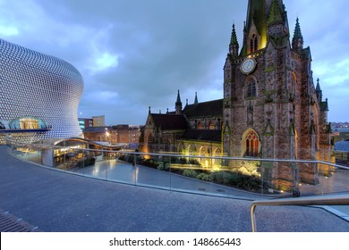 BIRMINGHAM, UK - JANUARY 30: Night scene in downtown Birmingham, UK on January 30, 2012 with the parish church St. George in the Bullring and the Selfridges Department Store.