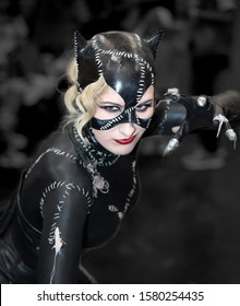 BIRMINGHAM, UK, - JUNE 2, 2018.  A sexy cosplay Catwoman in close up with cat costume and claws at a UK comic con event