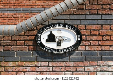 Birmingham, UK: June 29, 2018: Canal Side Walk plaque near Broad Street leading to the Birmingham Canal Navigations System. A restored district of historic significance from the industrial revolution.