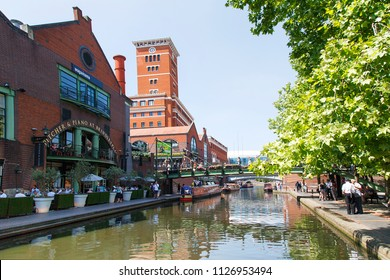 Birmingham, UK: June 29, 2018: Regency Wharf at Gas Street Basin. The restored canal system in Birmingham central is a national heritage landmark and where the Worcester and Birmingham canals meet.