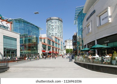 Birmingham, UK: June 29, 2018: The Bullring Shopping Centre - Birmingham. People shopping in the pedestrianised zone near Grand Central Station.