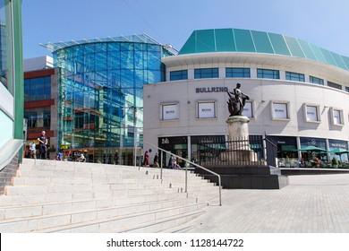 Birmingham, UK: June 29, 2018: The Bullring Shopping Centre - Birmingham. People walking through the pedestrianised zone near Grand Central Station.