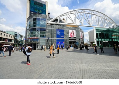 BIRMINGHAM, UK - MAY 14, 2014 - Shops along new street by the entrance to the Bullring shopping centre, Birmingham, West Midlands, England, UK, Western Europe, May 14, 2014.