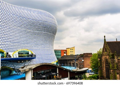 BIRMINGHAM, UK - MAY 19, 2017: People in front of modern Selfridges building in downtown of Birmingham, UK during the cloudy day
