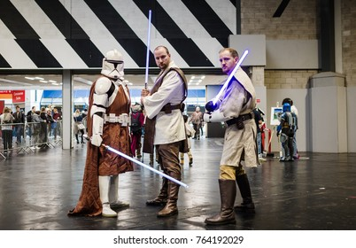 Birmingham, UK - November 18, 2017: Cosplayers dressed as two Jedi knights and a Mandalorian knight at Birmingham MCM Comic Con.