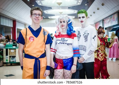 Birmingham, UK - November 19, 2017: Cosplayers dressed as Harley Quinn and the Joker from DC Comics and movie Suicide Squad with Goku from Dragon Ball Z at Birmingham MCM Comic Con.