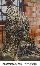 BIRMINGHAM, UK - NOVEMBER 19TH 2017: A replica prop of the Iron Throne as featured in the hit television series The Game of Thrones, at the NEC in Birmingham, on 19th November 2017.