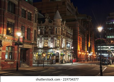 BIRMINGHAM, UK - SEPTEMBER 1, 2014: The building of Old Royal Pub an example of characteristic Victorian red brick and terracotta architecture in the center of the city at night.