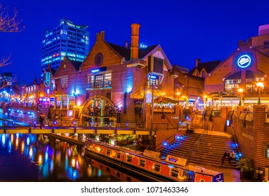 BIRMINGHAM, UNITED KINGDOM, APRIL 8, 2017: Night view of a restaurant alongside a water channel in the central Birmingham, England