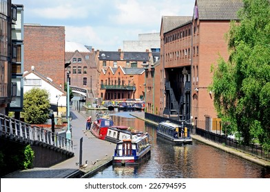 BIRMINGHAM, UNITED KINGDOM - MAY 14, 2014 - Narrowboats in Gas Street Canal Basin, Birmingham, West Midlands, England, UK, Western Europe, May 14, 2014.