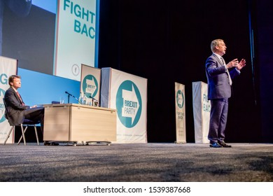 Birmingham, West Midlands / UK - April 13 2019: Richard Tice looks on as Nigel Farage addresses the audience at the Brexit Party Launch.