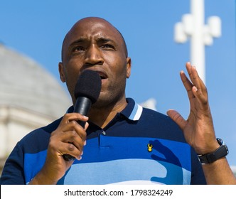 Birmingham, West Midlands / UK - Aug 9 2020: A guest speaker addresses the crowd at the We Matter pre-launch rally, a public event held in Centenary Square.