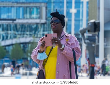 Birmingham, West Midlands / UK - Aug 9 2020: A woman watches on as events unfold at the We Matter pre-launch rally, a public event held in Centenary Square.