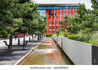 Birmingham, West Midlands/England UK - 06.16.2017: City University Curzon Building exterior with the water feature in the foreground.