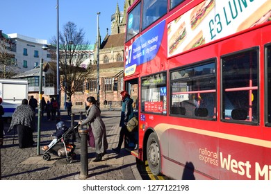Birmingham,England,UK. January 25th 2017.People disembark a West Midlands iconic red double Decker bus in the Bullring area of England's second largest city.