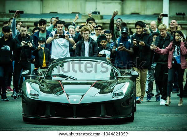 Birmingham,United Kingdom- July 28 2017: Ferrari event at Birmingham city centre, many people surrounded LaFerrari supercar to take photos and get a closer look.