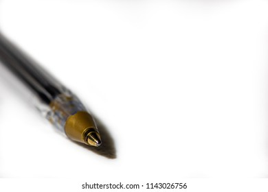 A biro pen on a white paper background, shot with a shallow depth of field