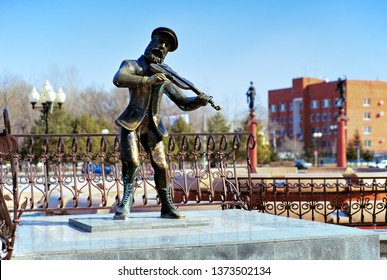 BIROBIDZHAN, RUSSIA – MARCH 9, 2008: Fiddler on the Roof statue at the Theater Square. The statue of Tevye the Dairyman, the character of tales by Sholem Aleichem, was erected in 2004.