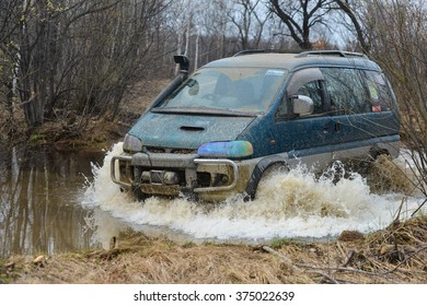 "Birobidzhan,Russia-may 2, 2015 : Birobidzhan, Russia-may 2, 2015 : the  mitsubishi delica is driven on the offroad on ""JPG orientation"""