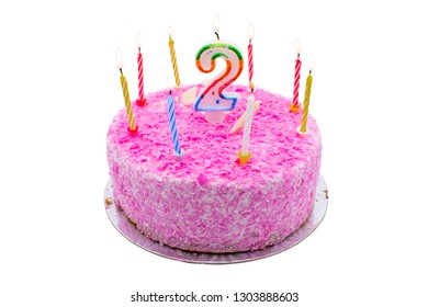 birtday cake with burning candle number 2 (two) two year old birtday cake. burning candles on pink cake on white background