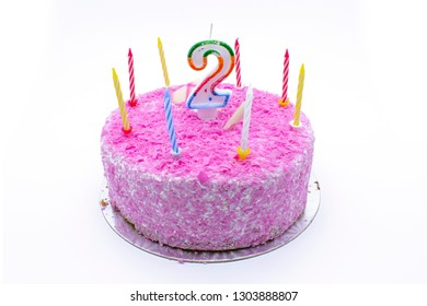 birtday cake with burning candle number 2 (two) two year old birtday pink cake on white background