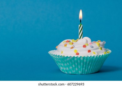 birtday cupcake with green burning candle