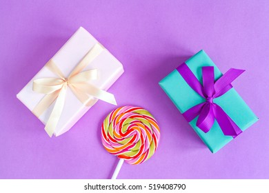 birth of baby - gift box on purple background