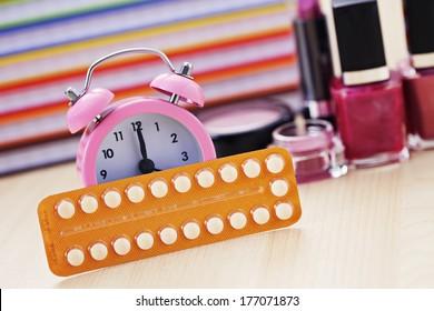 birth control pill with alarm clock - healthcare and medicine