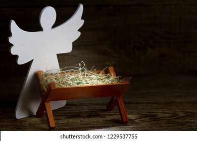 The birth of Jesus Christ abstract christmas nativity scene with manger and angel