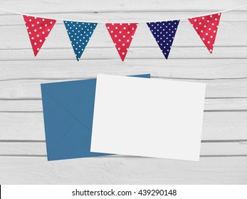 Birthday, baby shower mockup scene with envelope, blank card, party flags. Wooden background. Empty space for your text, top view.