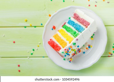 Birthday background - striped rainbow cake with white frosting