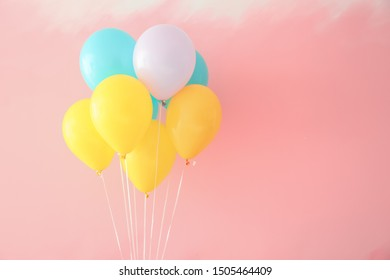 Birthday balloons on color background