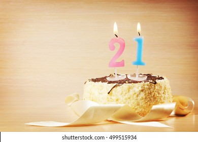Birthday Cake With Burning Candle As A Number Twenty One Focus On The