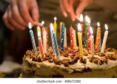 Birthday cake with burning candles in the dark background