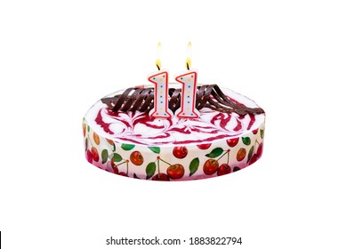 Birthday cake with burning candles in form of number 11, isolated on white background