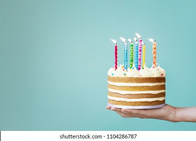 Birthday cake with buttercream and colorful candles