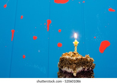 Birthday cake with a candle on a blue background