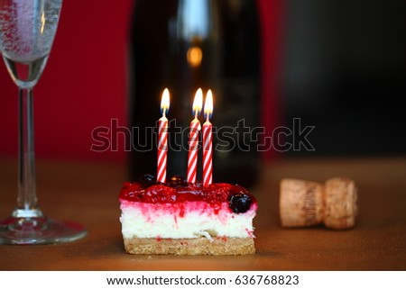Birthday Cake With Candles Cheesecake Glass Of Cold Sparkling Champagne And Cork